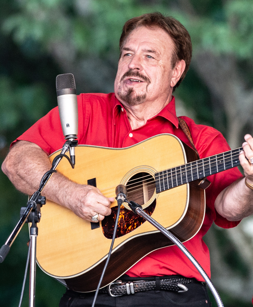 Vernon McIntyre performing with his band, Vernon McIntyre's Appalachian Grass at Greenhills Commons on July 11, 2018. Photo by Ron Rack.
