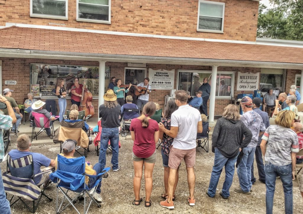 picture of concert by Vernon McIntyre's Appalachian Grass in front of store at Vernon McIntyre's Famous Old Time Music Company Grand Opening August 31, 2019